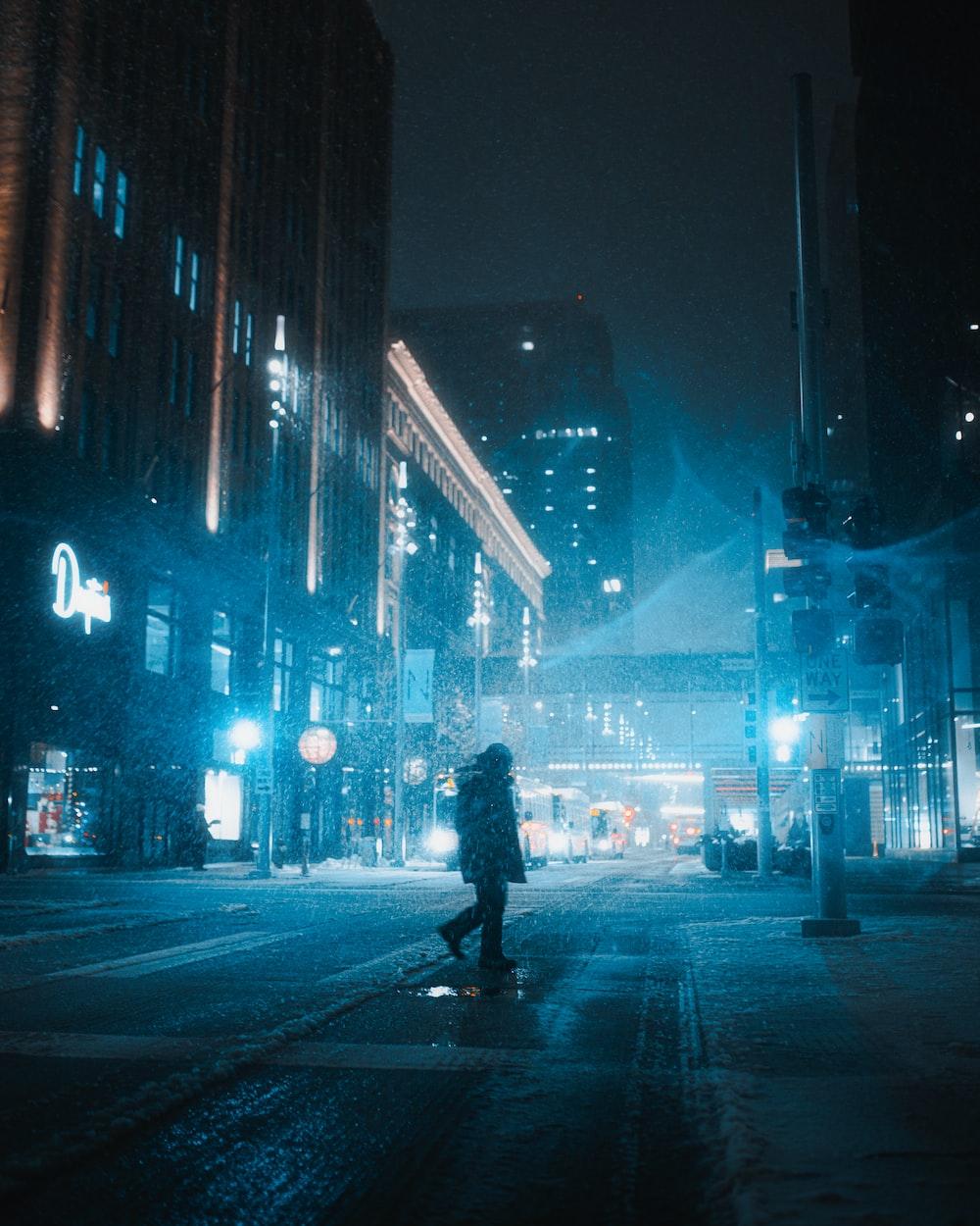 silhouette of man walking on pedestrian lane