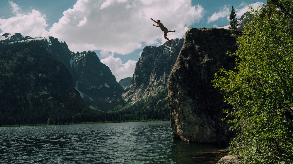 person jumping on edge
