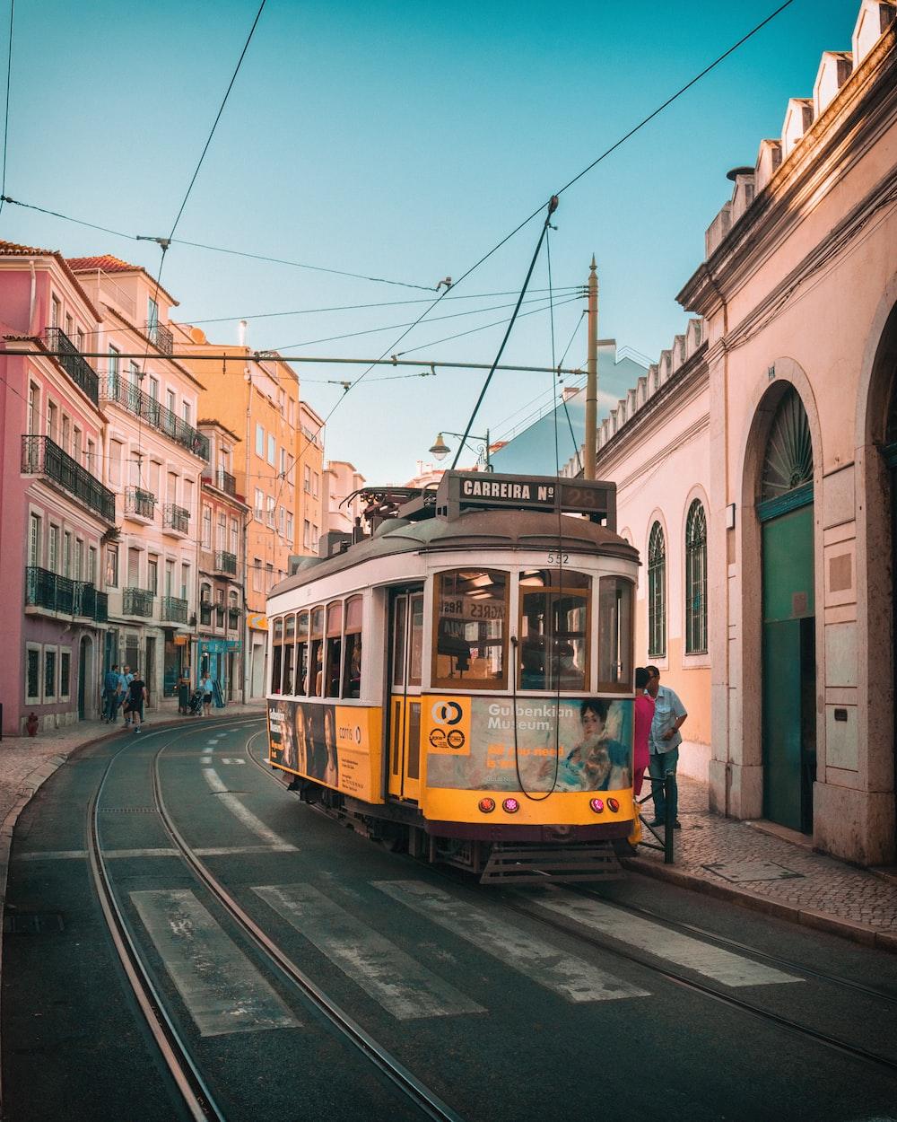 white and yellow tram