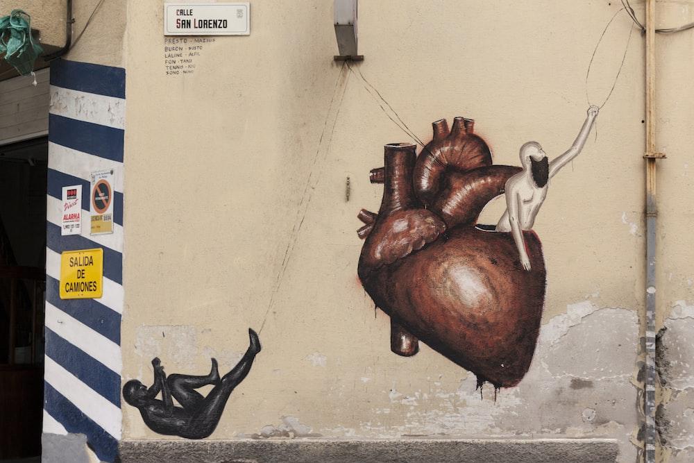 brown human heart illustration
