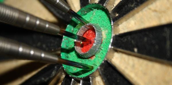 Some darts in a dartboard.