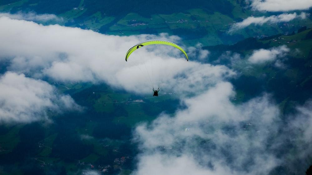 person riding parasailing