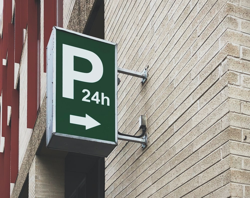 white and green P24h signage