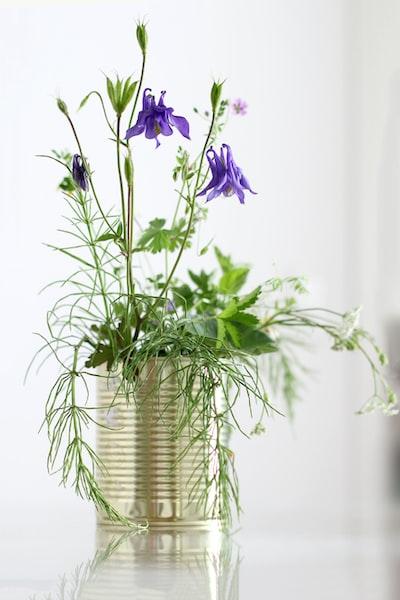 purple flowers in silver vase
