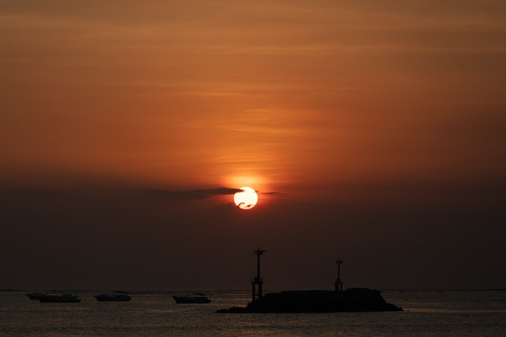 boats on sea during sunset