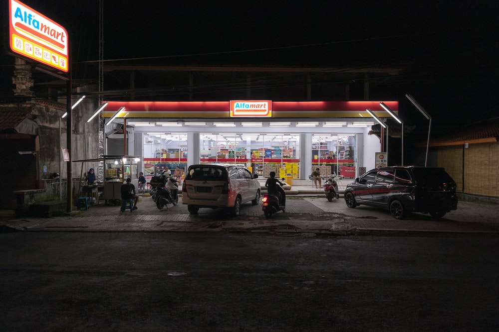 vehicles parked in front of store facade