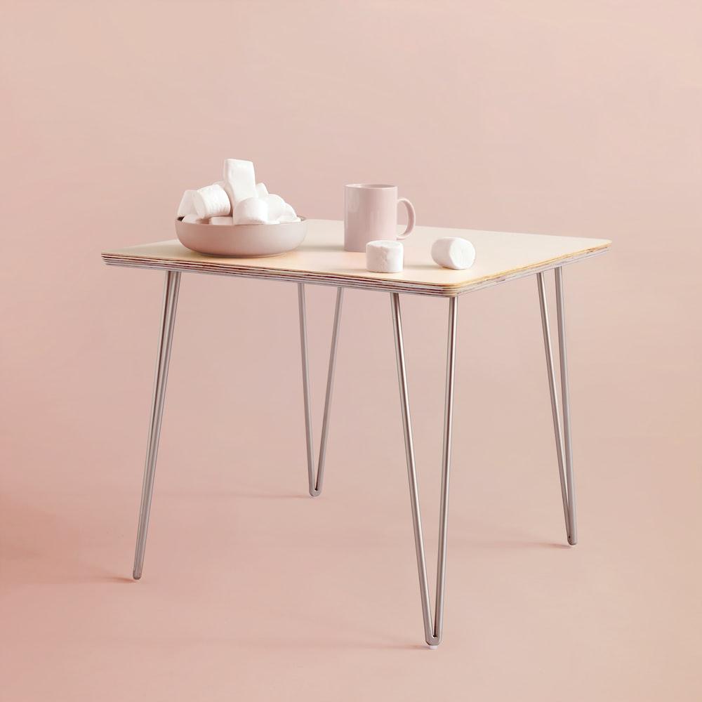 pink mug on table with marshmallows