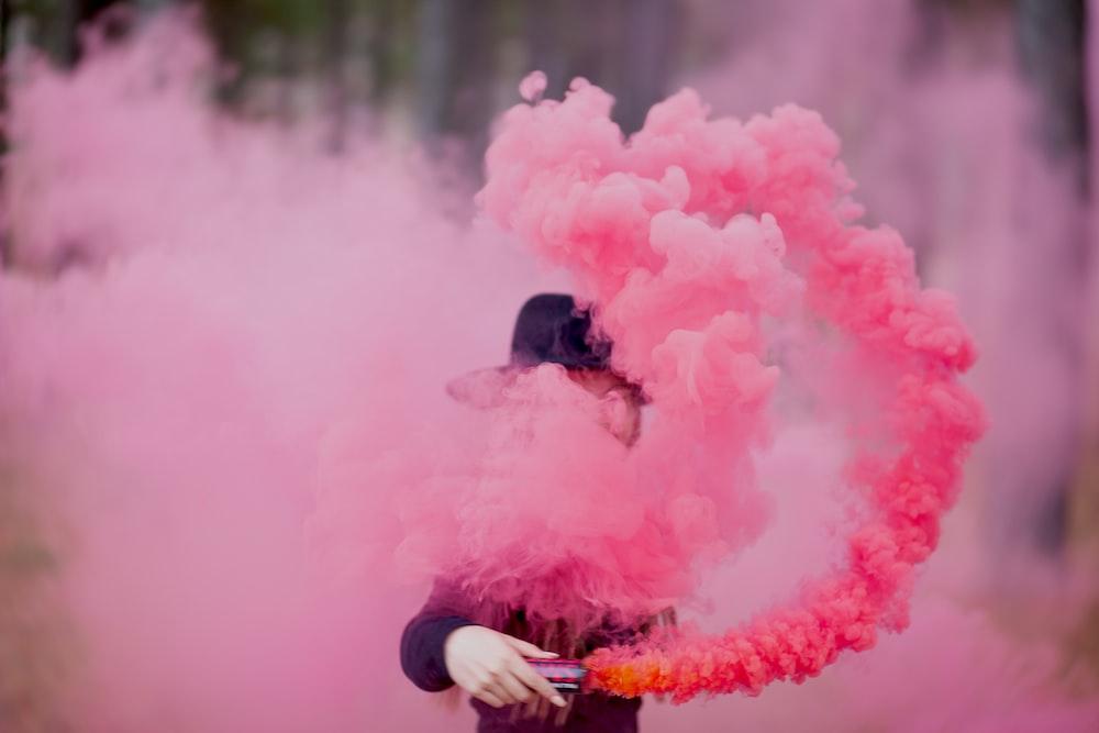 woman holding pink smoker