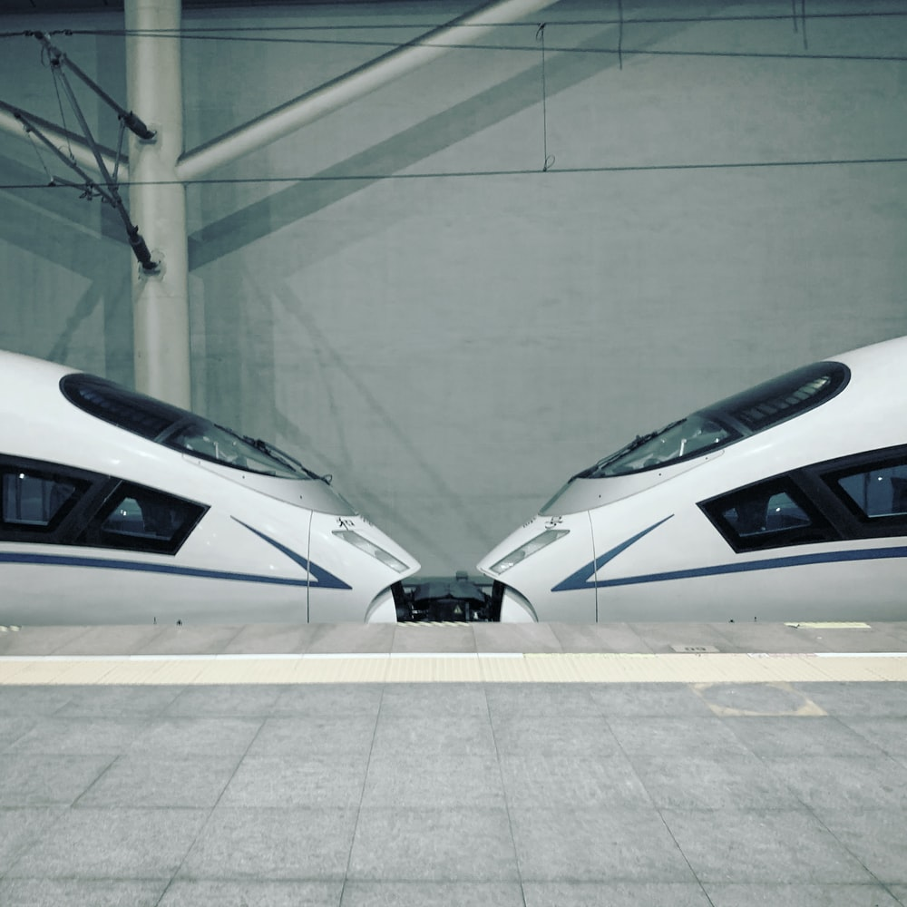 shallow focus photo of white trains