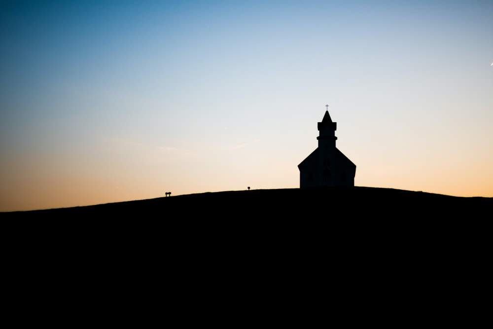 silhouette of building during daytime