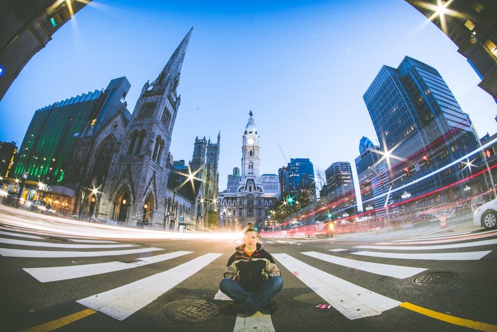 man sitting on road