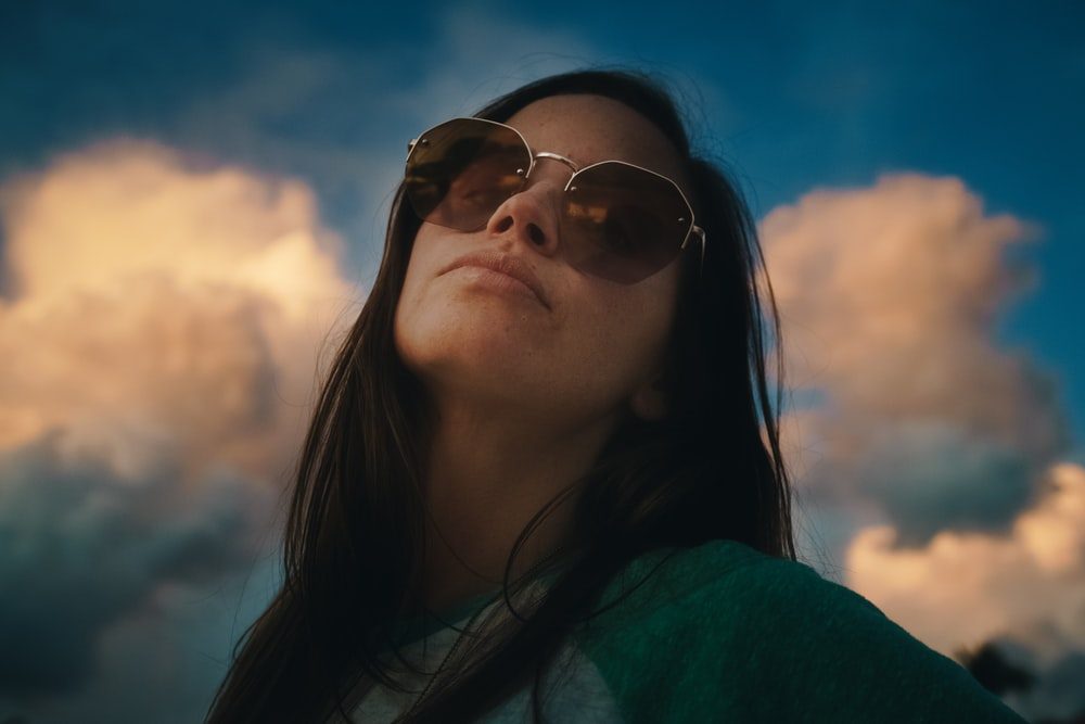 woman in gold-framed sunglasses