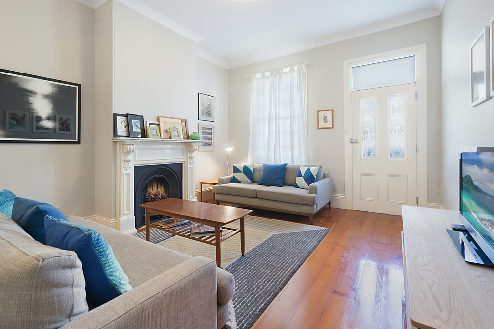 wooden table near sofa in living room