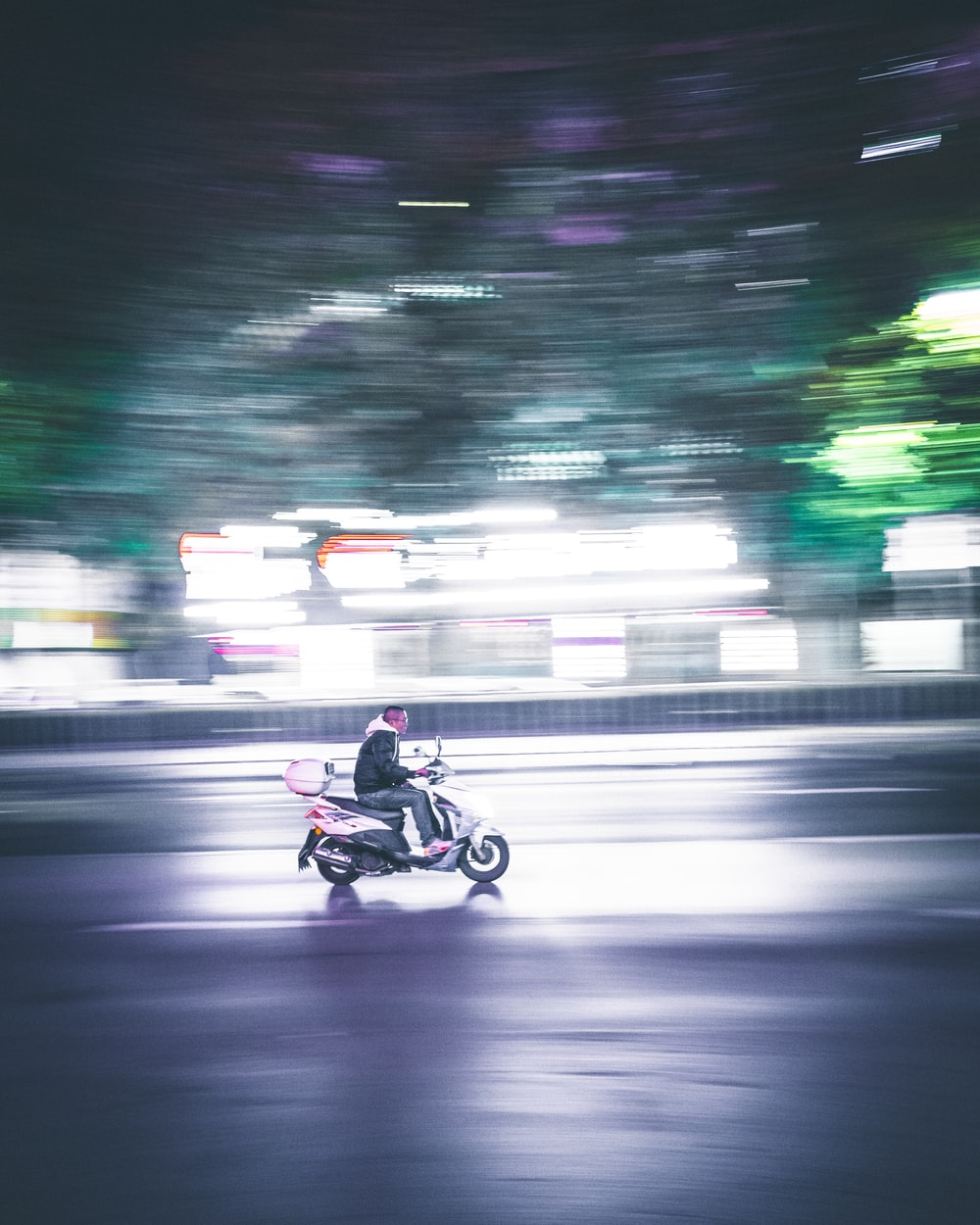 person riding motor scooter