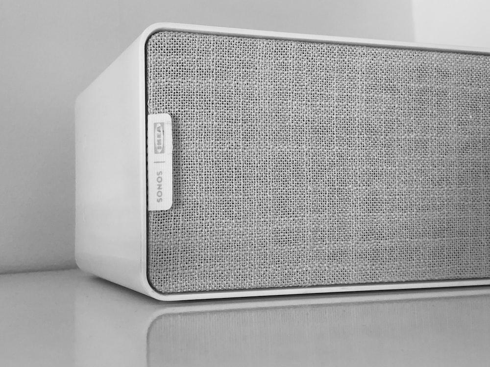 gray speaker on white surface