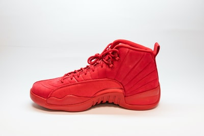 unpaired red air jordan 12 shoe zoom background