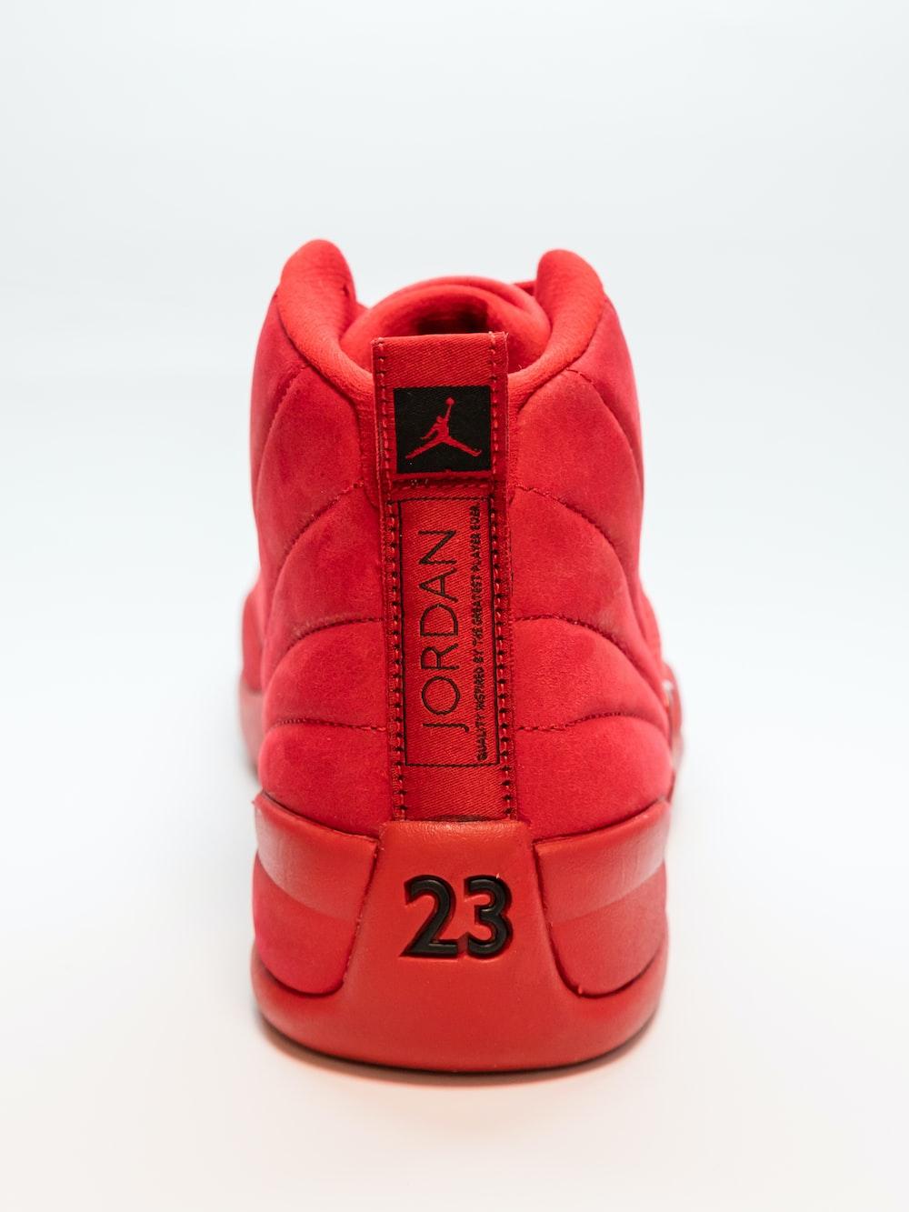 unpaired red Air Jordan basketball shoe