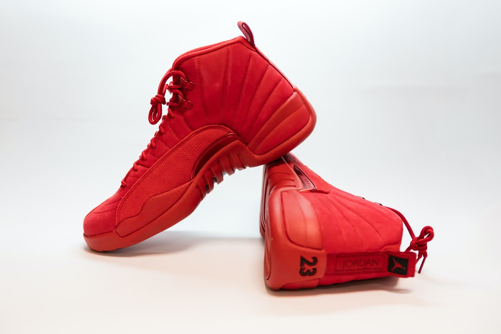 pair of red Air Jordan 12's