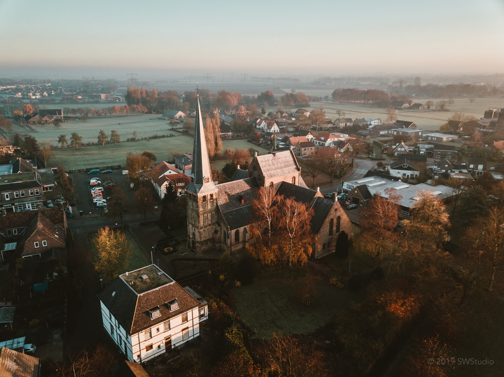 aerial photography of houses on green field during daytime