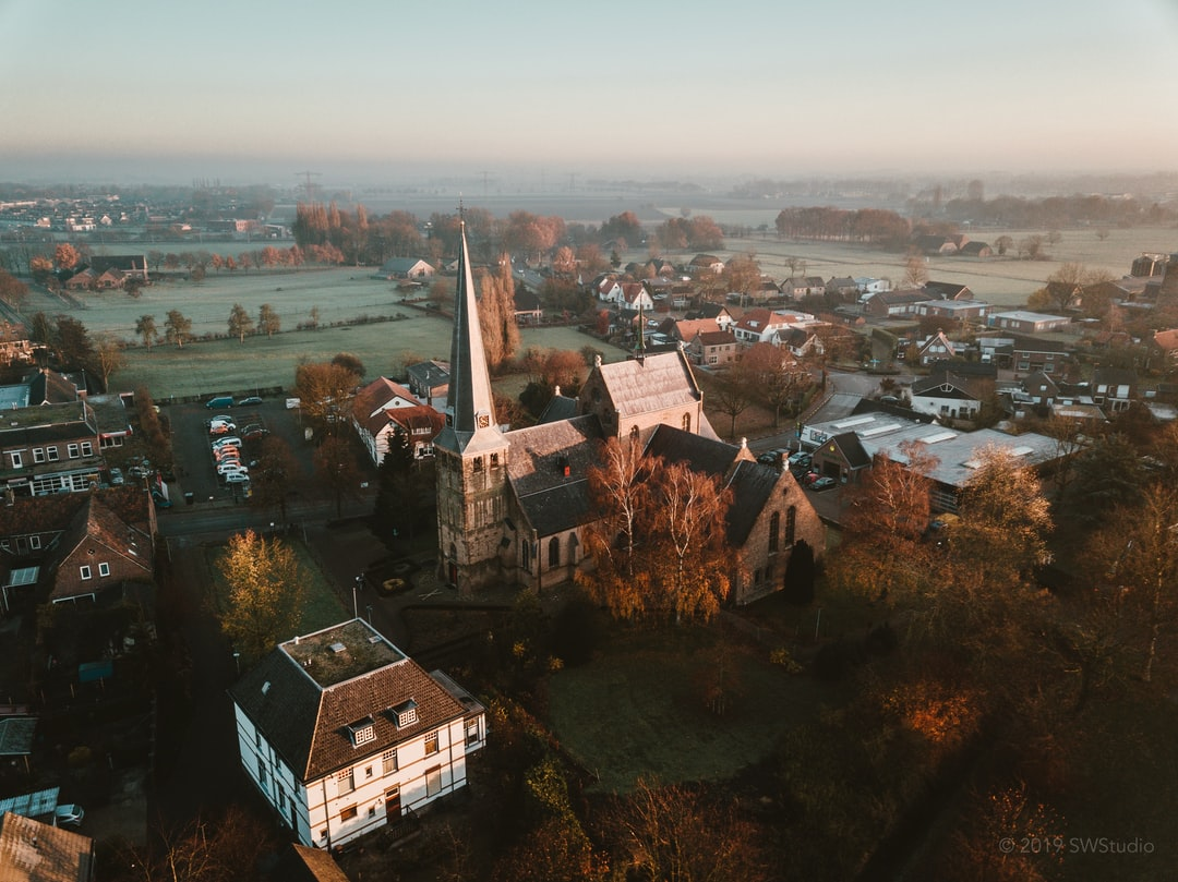 Small little Dutch town in the early morning winter fog.