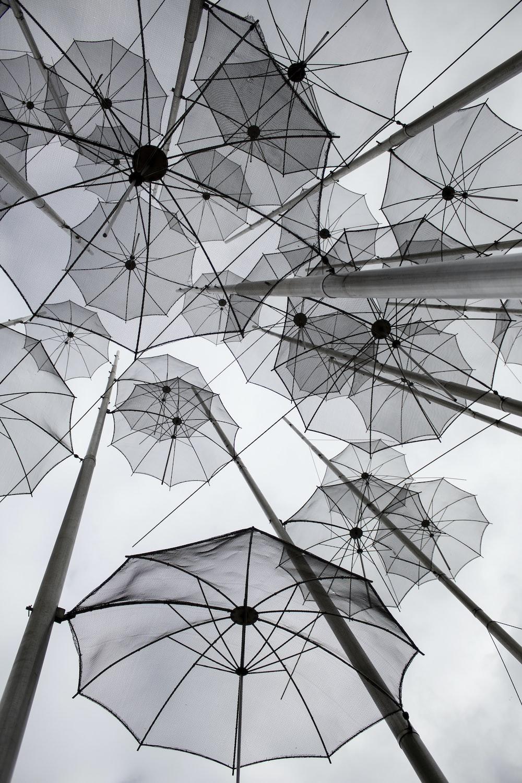 gray umbrellas on string