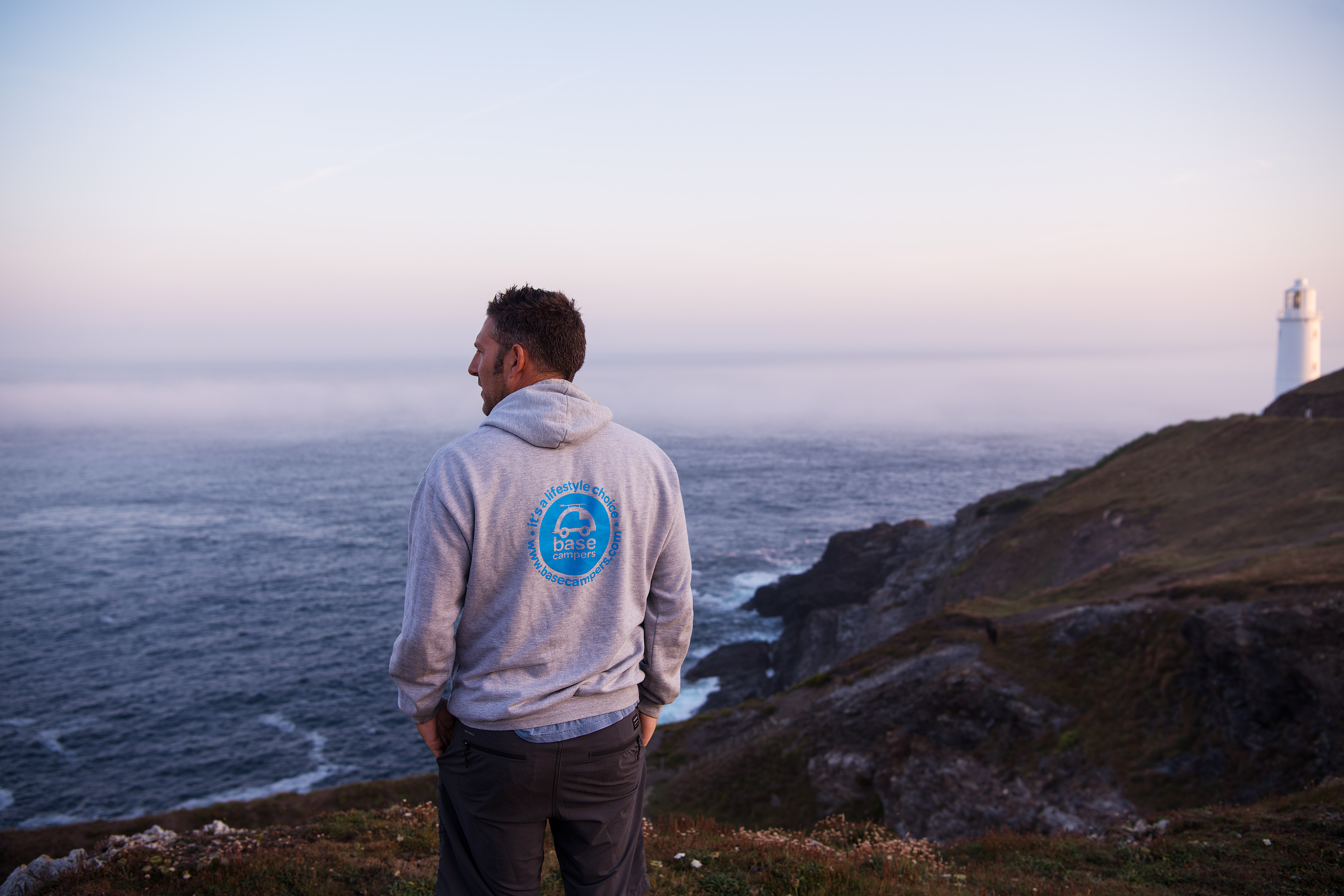 Picture of a man watching the sea from a clifftop.