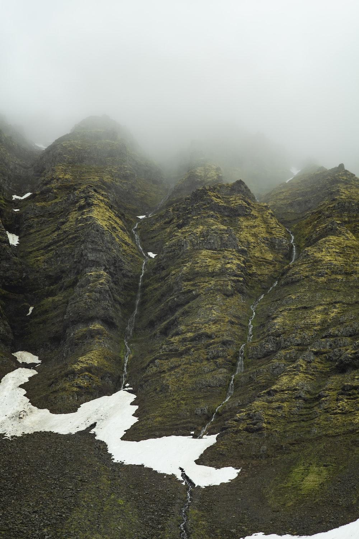 mountain under grey sky
