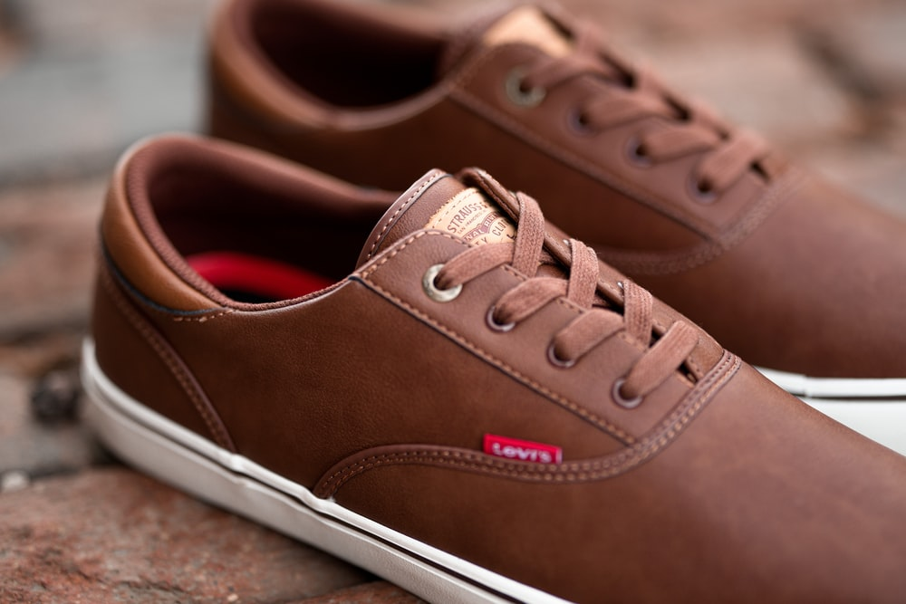 pair of brown Levi's low-top shoes