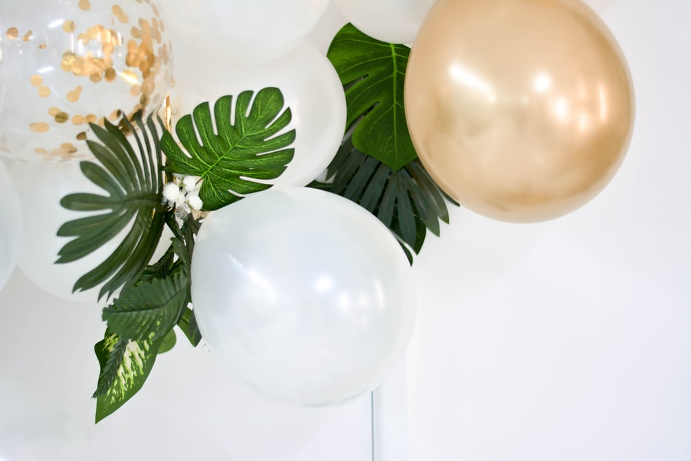 two gold and white balloons