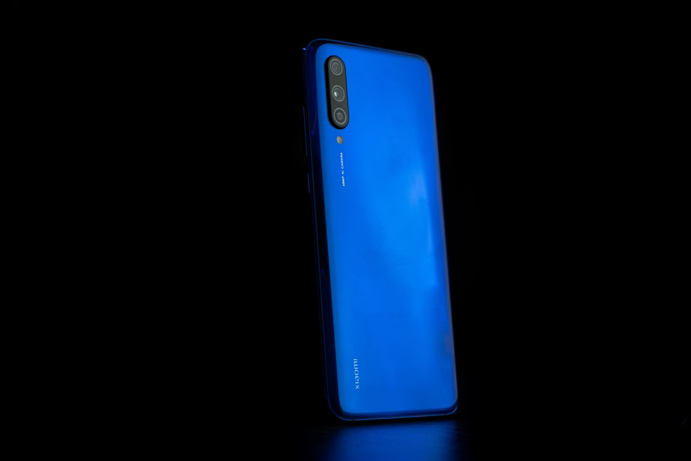 blue and black Xiaomi smartphone