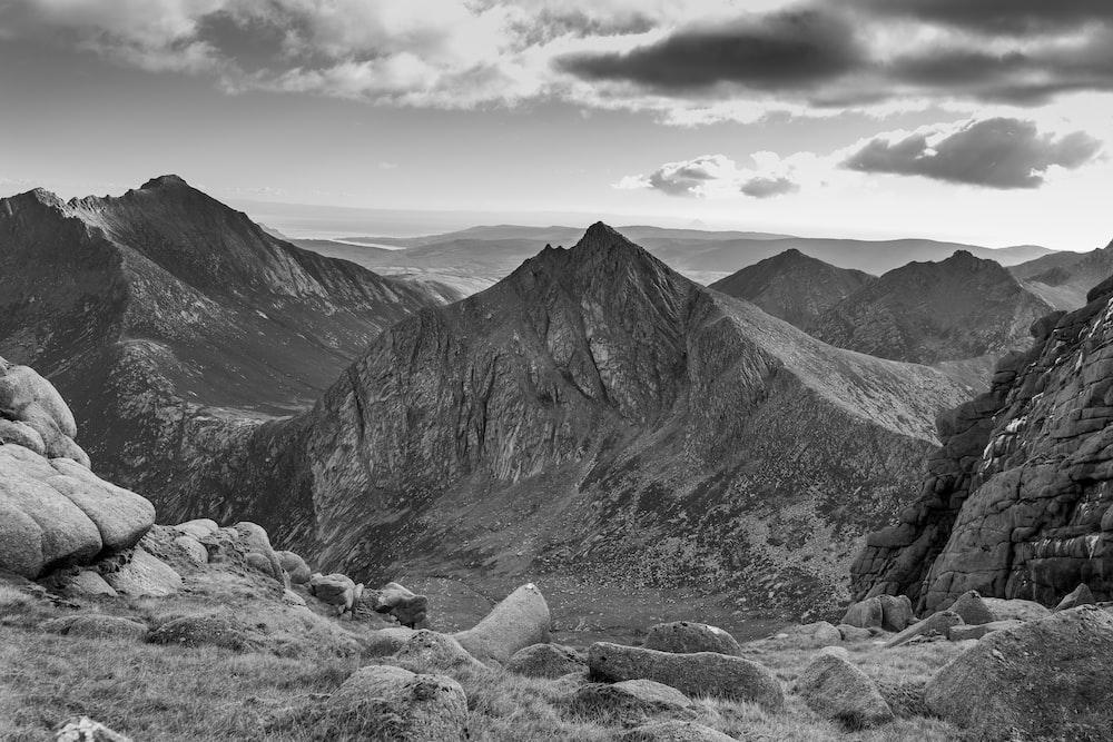 greyscale photo of mountains