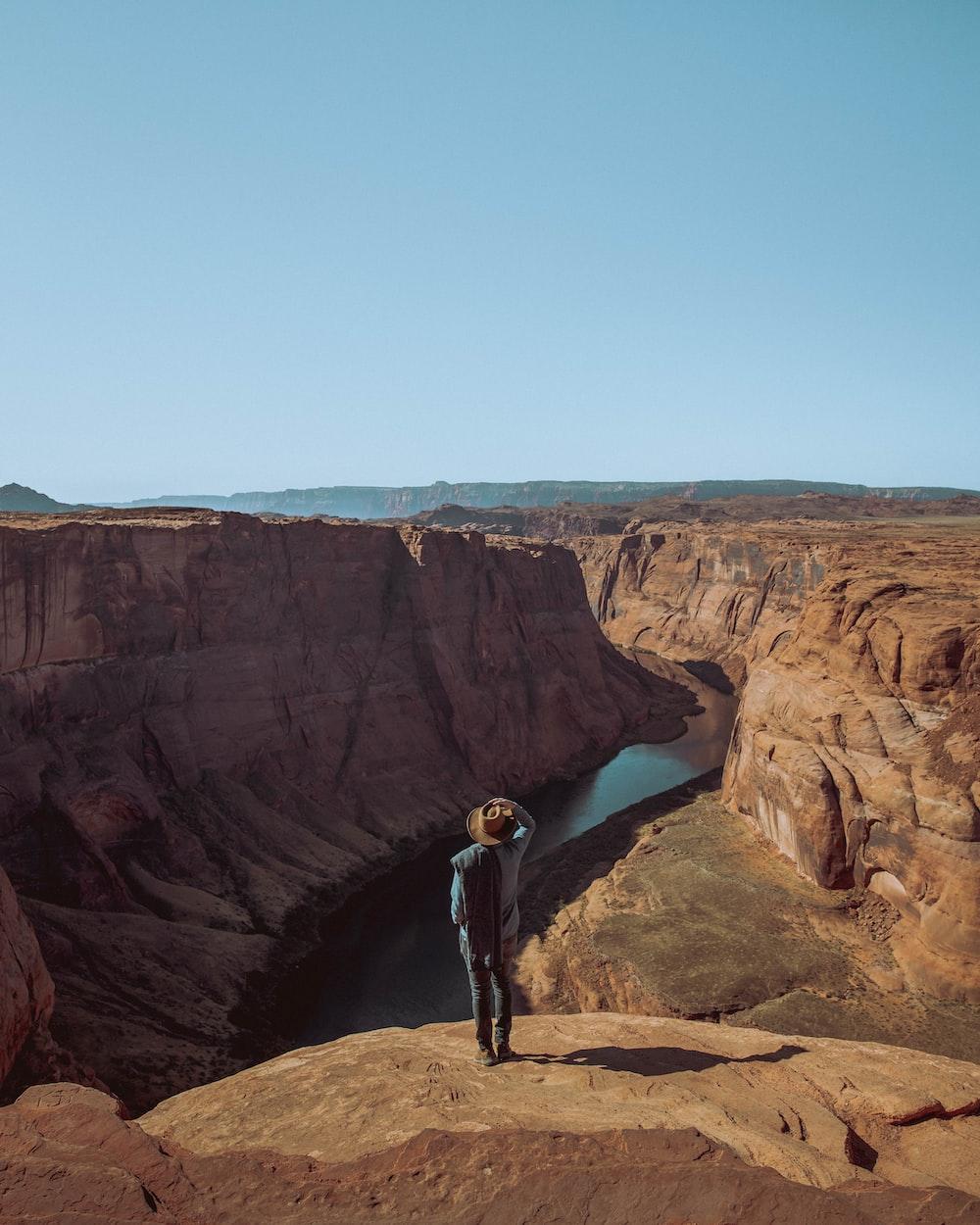 man standing on rock edge