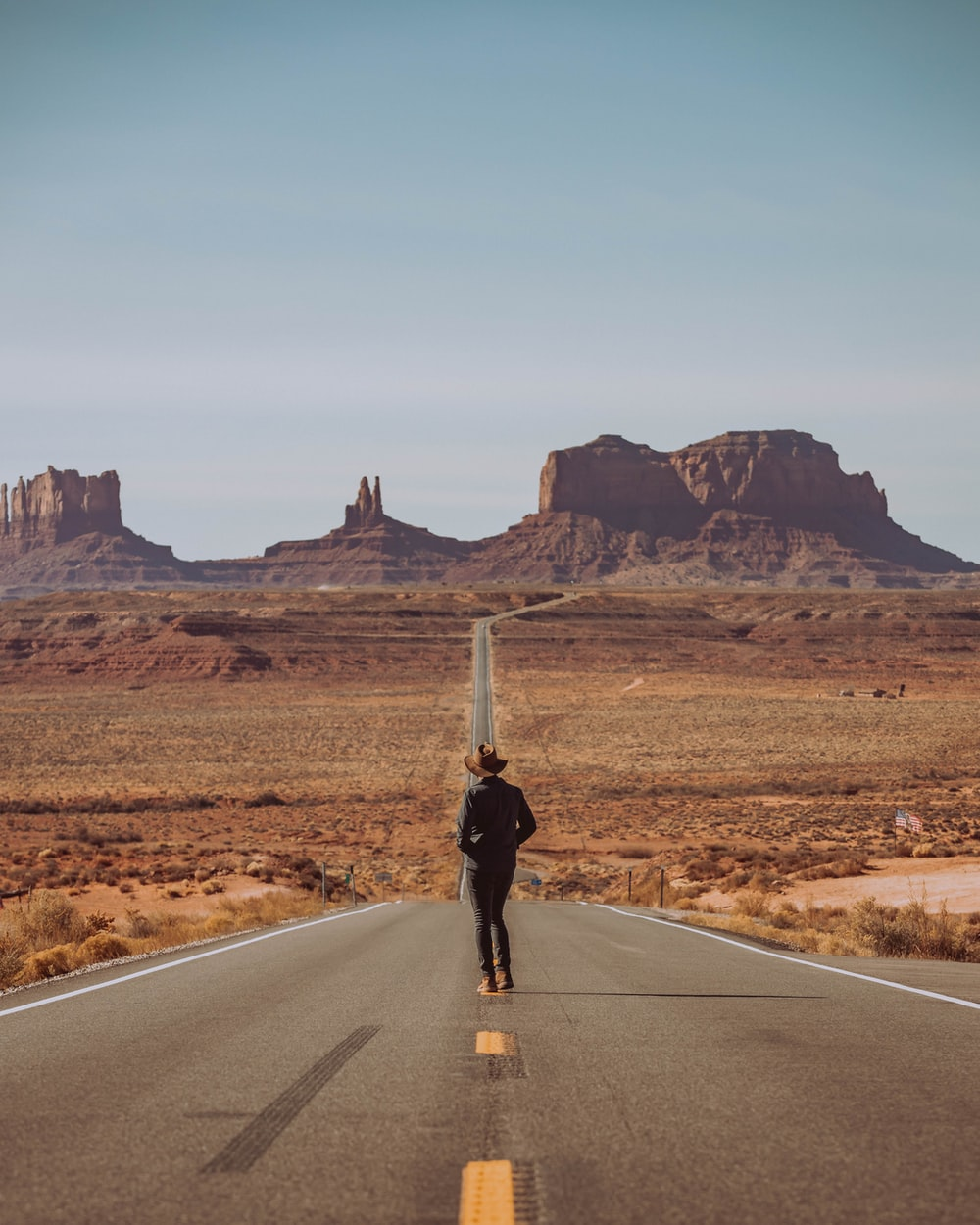man standing in the middle of road