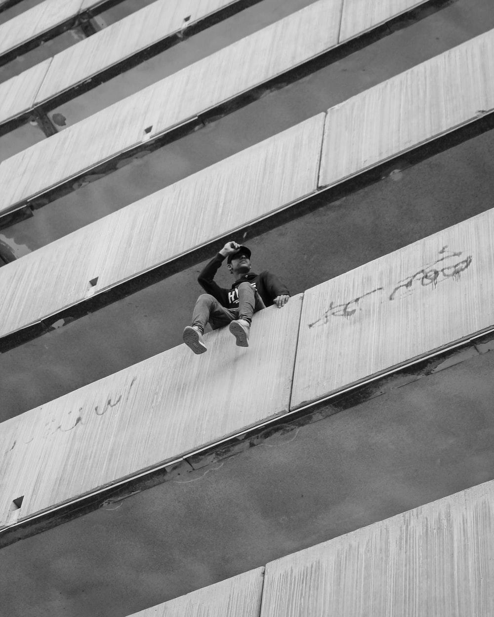 man sitting on building