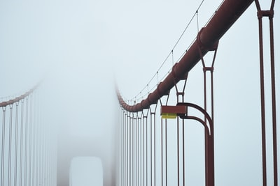 fog covering red bridge bow zoom background