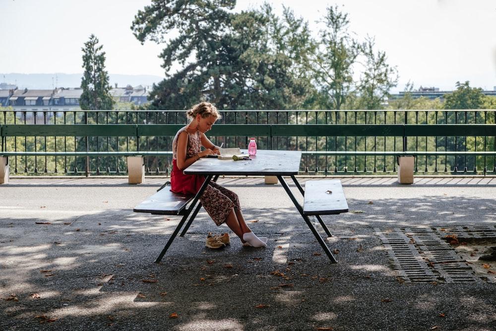girl sitting at bench