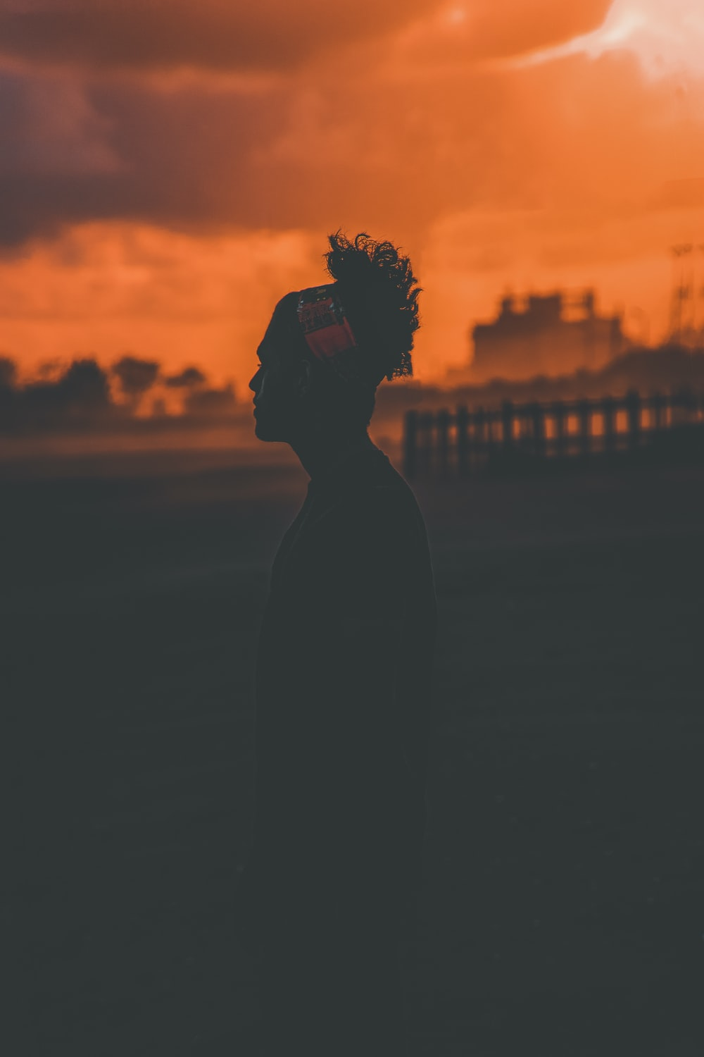 silhouette of standing person during golden hour