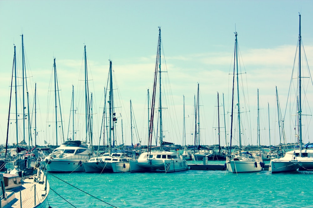 white boats on body of water during daytime