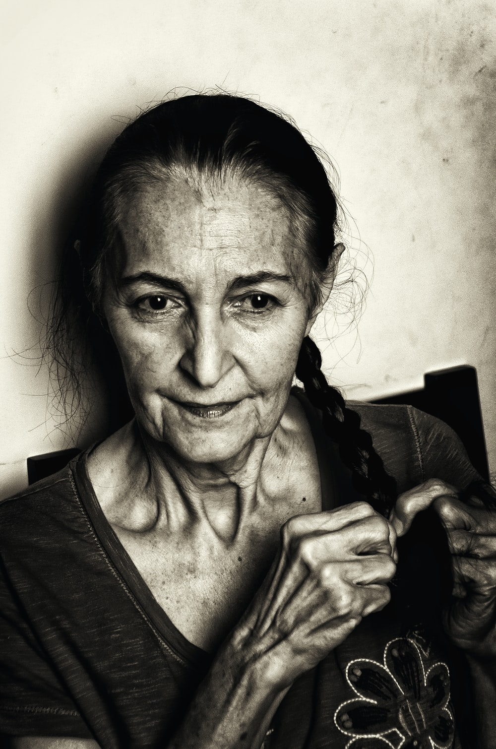 grayscale photo of woman with braided hair