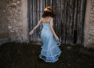 woman wearing blue spaghetti strap dress
