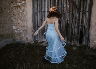 woman wearing blue spaghetti strap dress