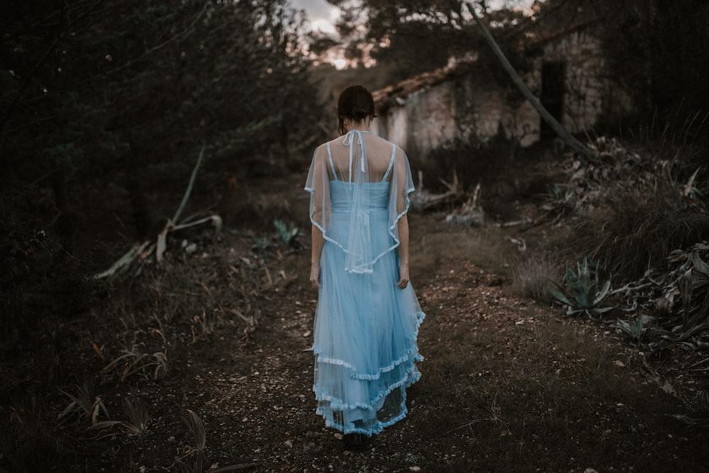 woman wearing blue dress during daytime