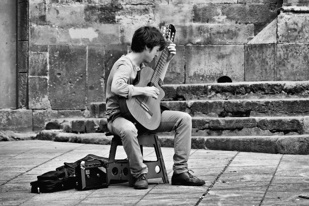 man playing guitar photograph