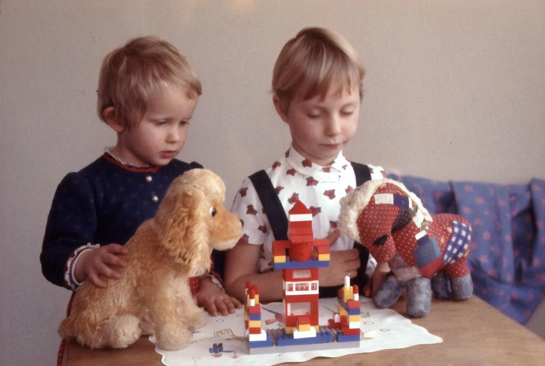 1964, children with stuffed animals and Lego bricks.