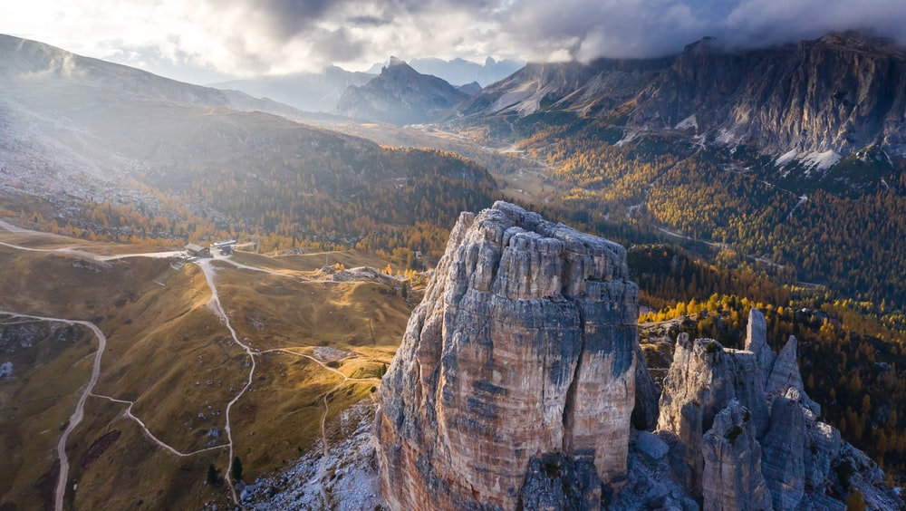 aerial photography of mountain and road