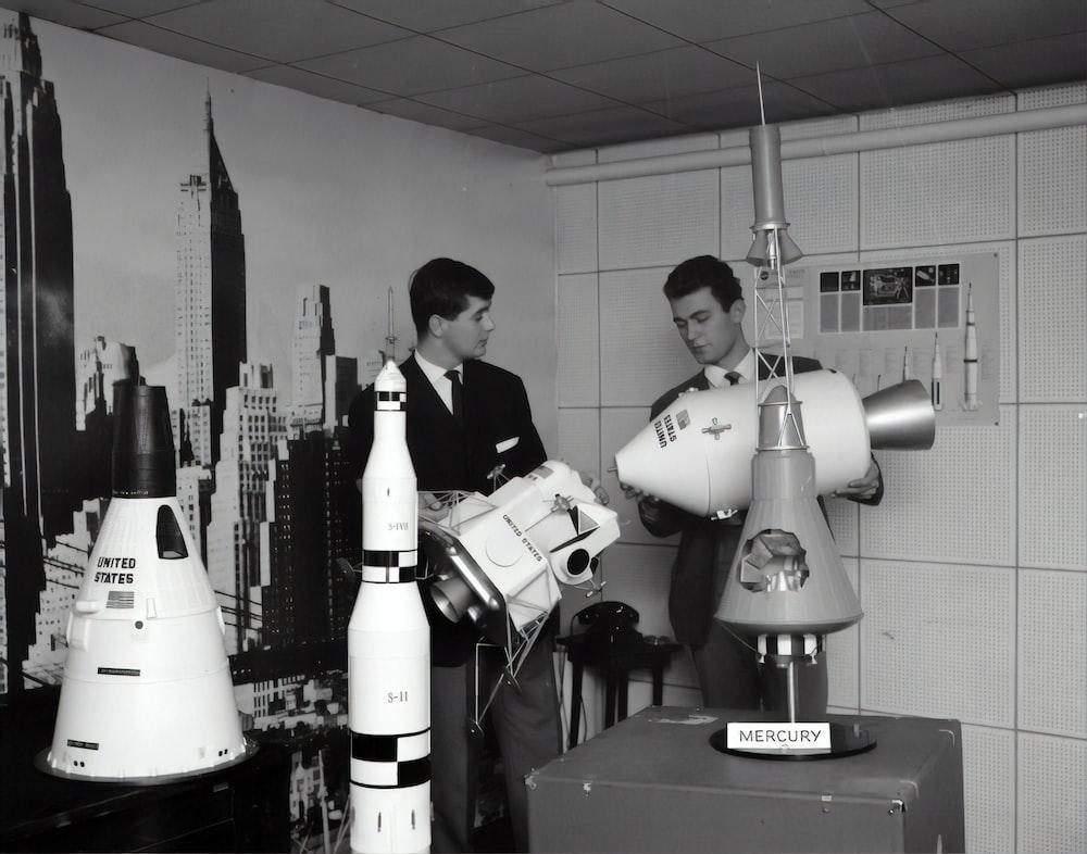 two men near machines