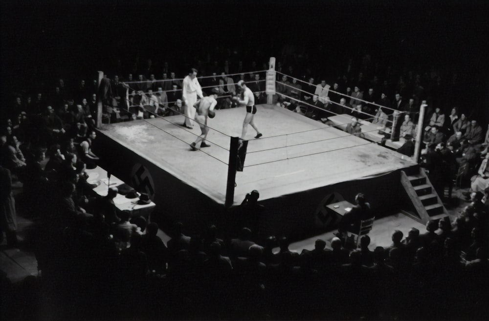 grayscale photo of boxing game