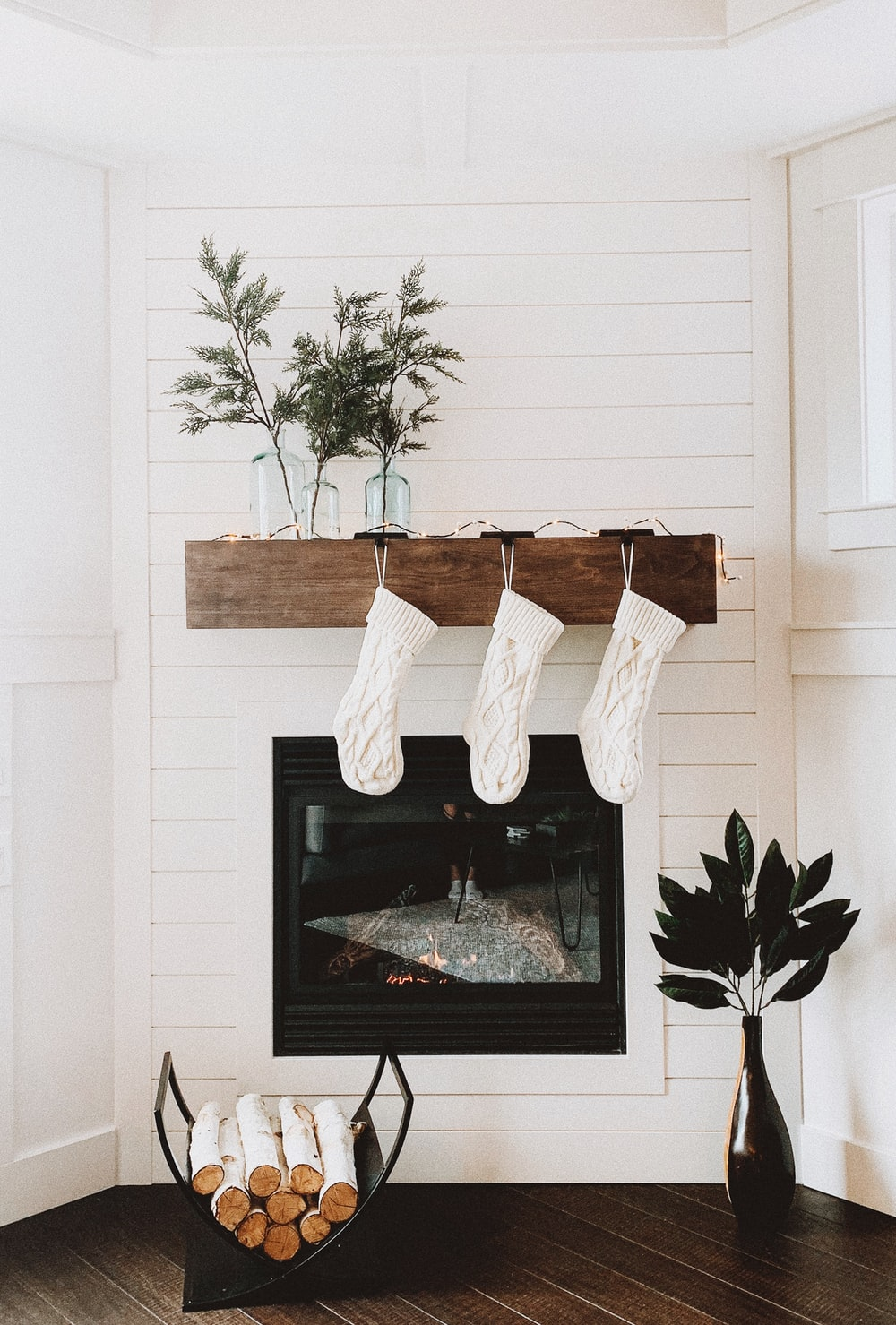 firewood on rack near fireplace