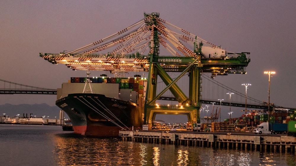 cruise ship beside dock during nighttime
