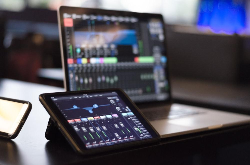 turned-on iPad and MacBook
